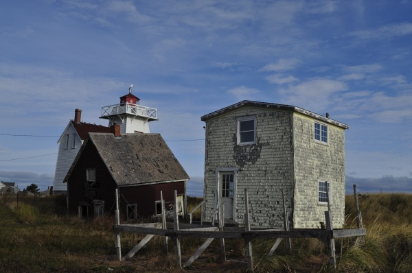 Shanties and the lighthouse lining North Rustico Harbour on PEI