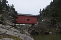 One of the many covered bridges in the Acadia region, spanning the Wolf river in Fundy National Park, New Brunswick