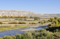 The sagebrush steppe starts rising above the river