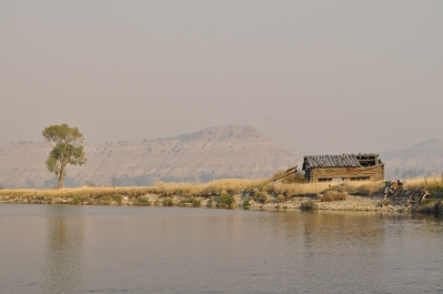 More quintessential Wyoming: dilapidated shack with butte in background and haze from wildfire smoke