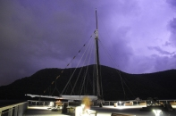 Safely docked at the town of Cold Spring as lightning flashes illuminate the boat in the Hudson Highlands