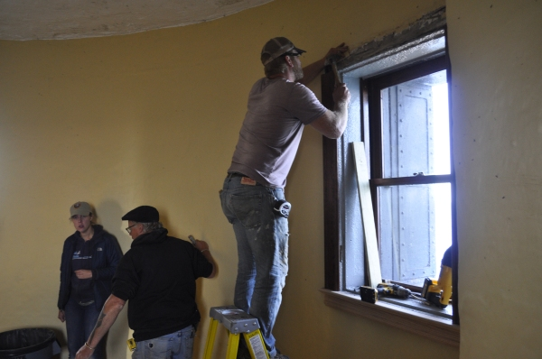 Josh and the crew installing the final piece of window trim