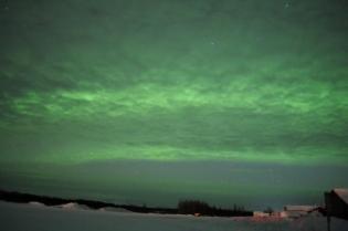 Aurora illuminating overcast skies